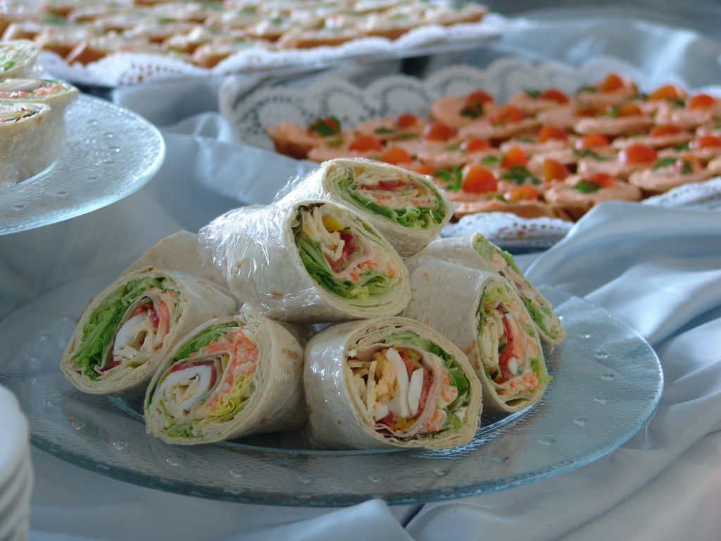Catered food on a white table cloth